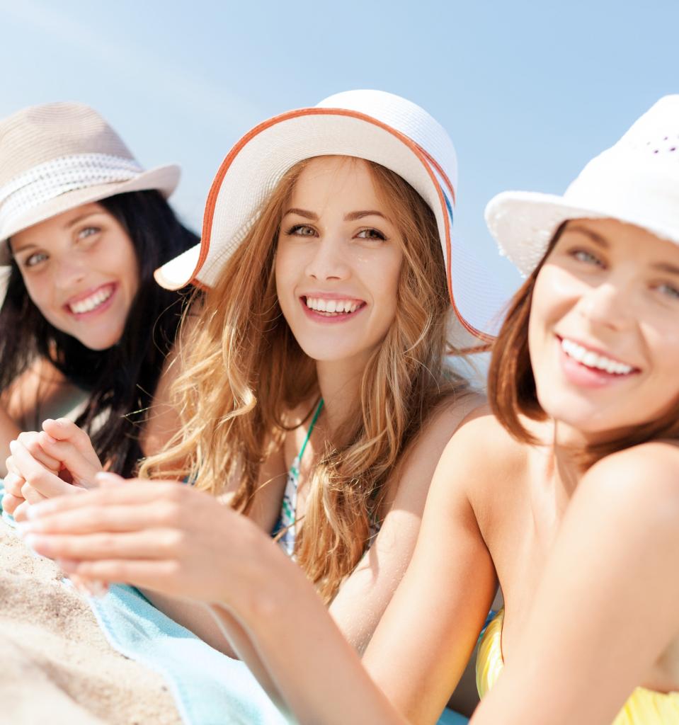 Three girls having fun at the beach